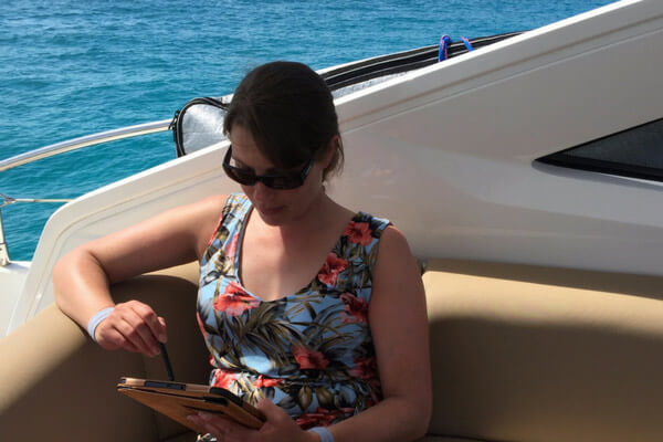 Benefits Woman on a boat blogging